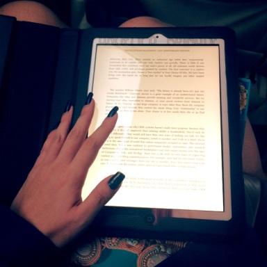 reading kindle ipad inside of a moving car