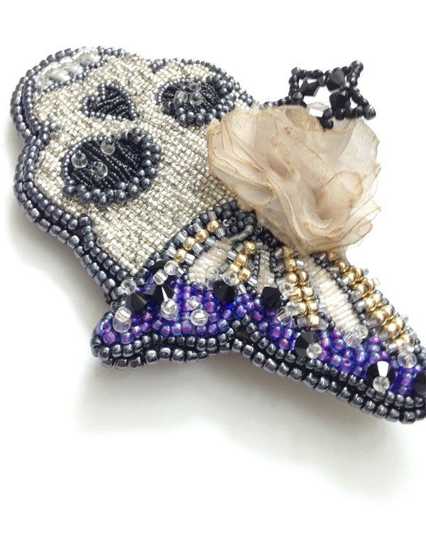 the serenity prayer of an ephemeral and imperfect beauty beaded hair accessory by angelica brigade beadwork beadworks hair fascinator comb by angelicabrigade skull silk flower butterfly